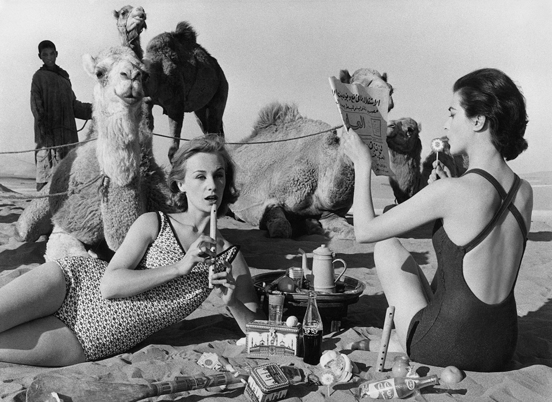 William Klein - Tatiana + Marie Rose + Camels, Morocco, (Vogue),1958