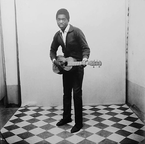 A Musician with Guitar, 1963