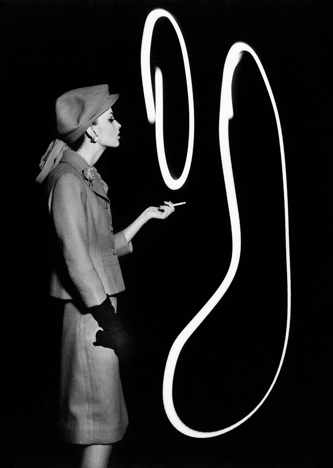 Dorothy blowing light smoke rings, Paris, 1962