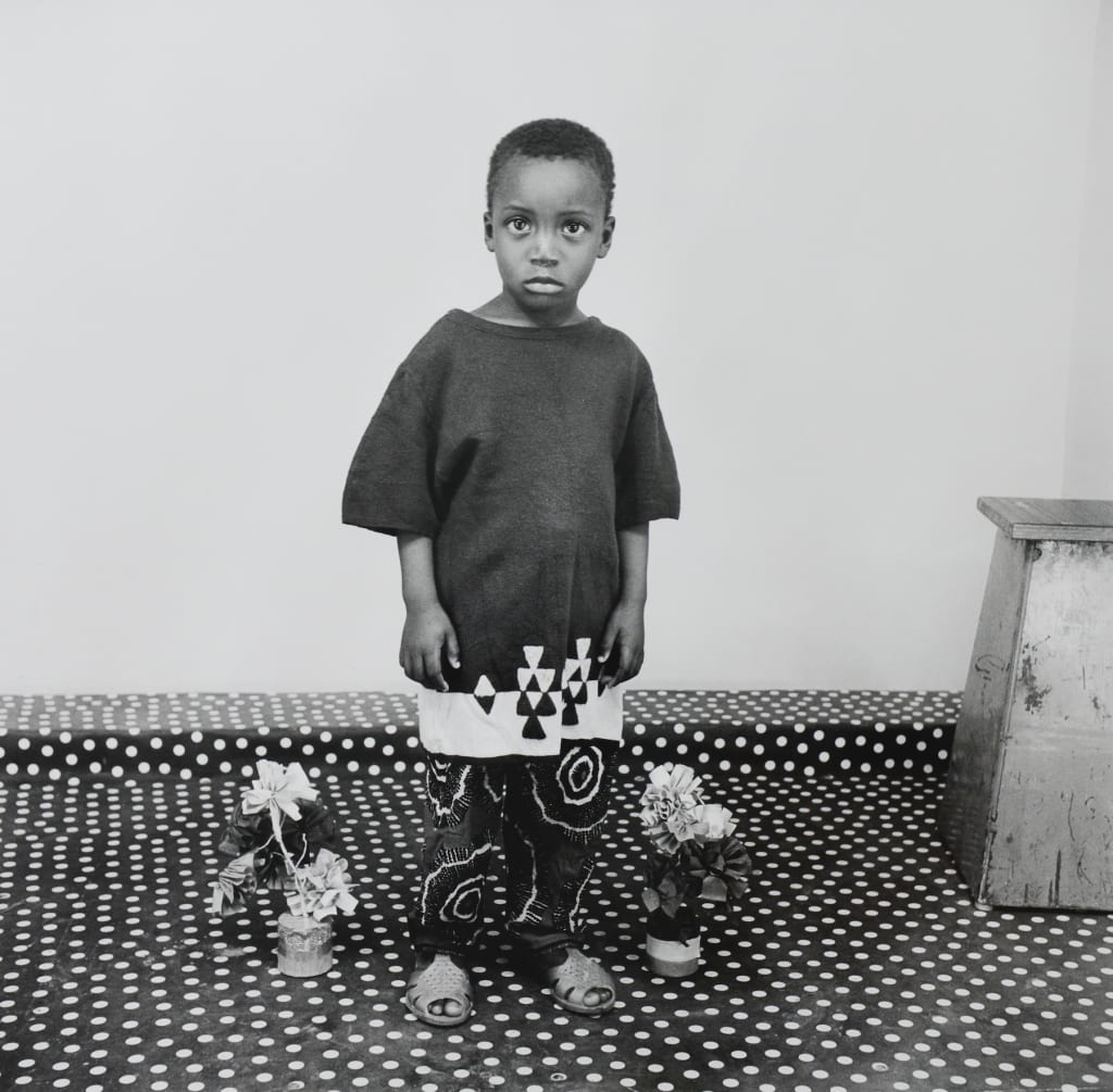 Studio Portrait, A Child In Love with Flowers, 1975
