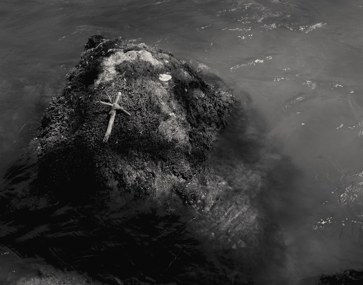 Untitled 45-Ex Voto-Alys Tomlinson-black and white photography-ex voto cross on rock in water