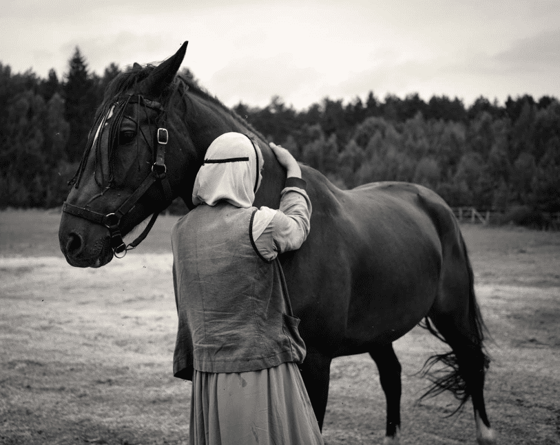 Alys Tomlinson - Vera - nun and horse - black and white photography