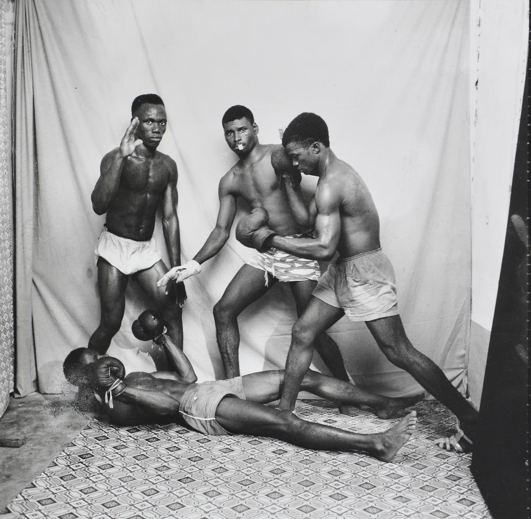 Malick Sidibe-Boxers Posing-HackelBury Fine Art-black and white photograph of four boxers posing in a photography studio