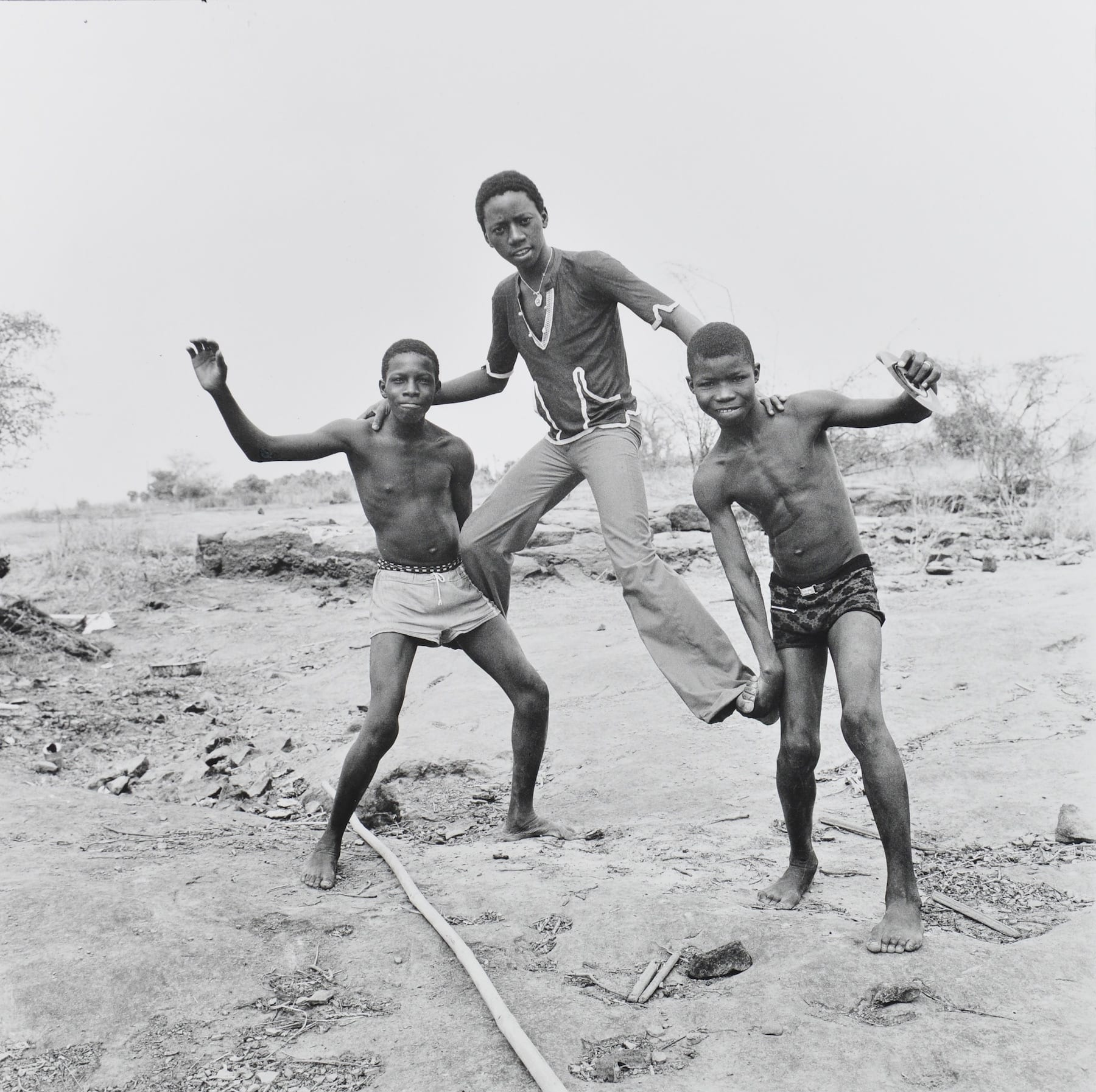 Malick Sidibe-On the Shores of the Niger-HackelBury Fine Art-black and white photograph of three people making a pyramid on the beach