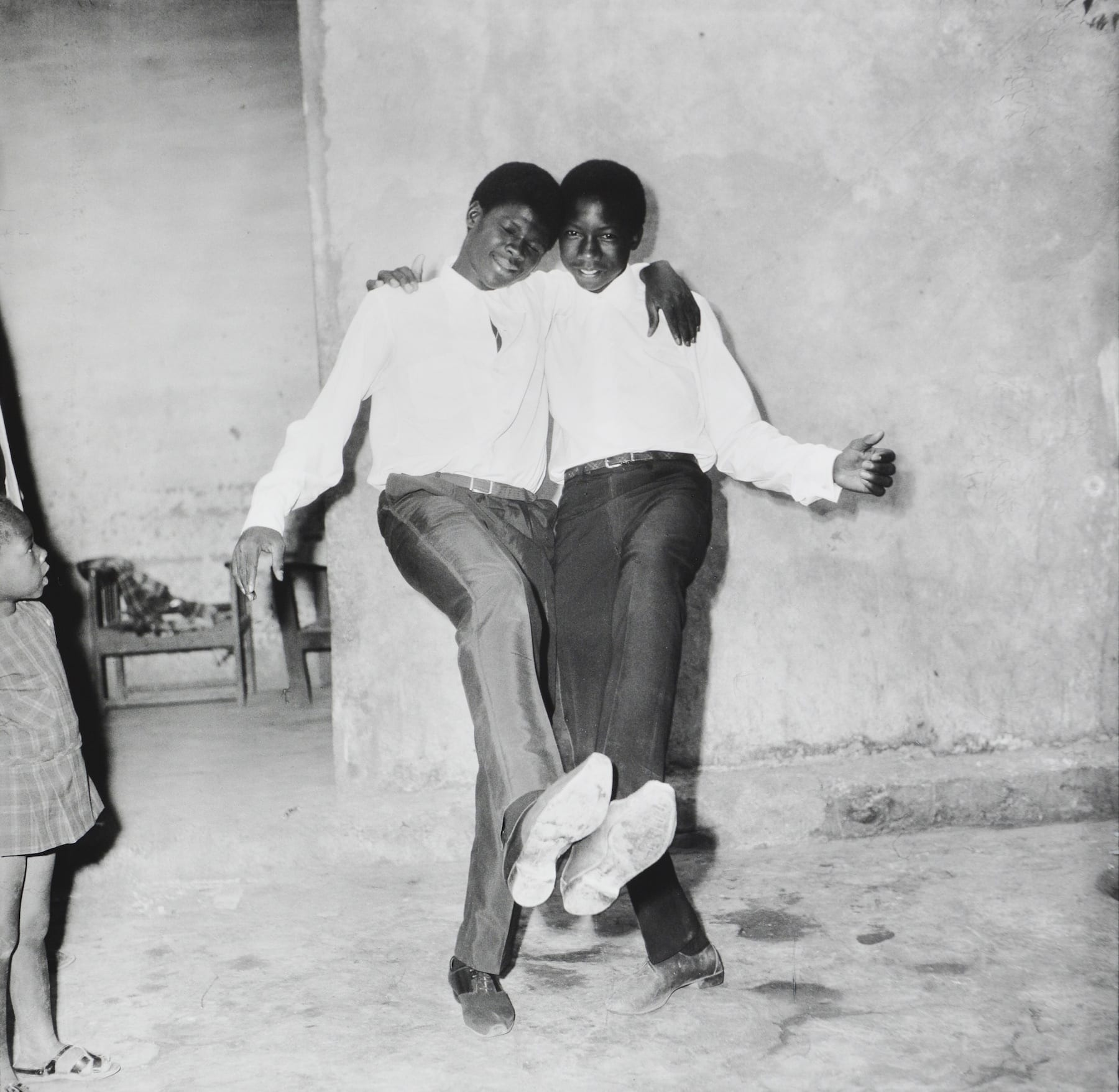 Malick Sidibe-Show of Two Friends-HackelBury Fine Art - black and white photograph of two people with their arms around each other