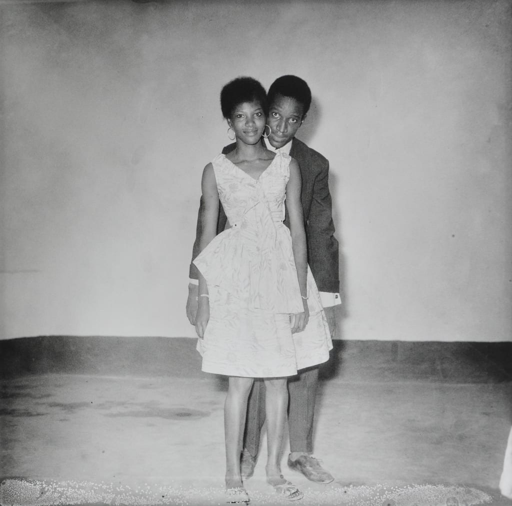 Malick Sidibe-The Arrival of Sacko Abdoulaye-HackelBury Fine Art-black and white photograph of a man and a woman dressed up