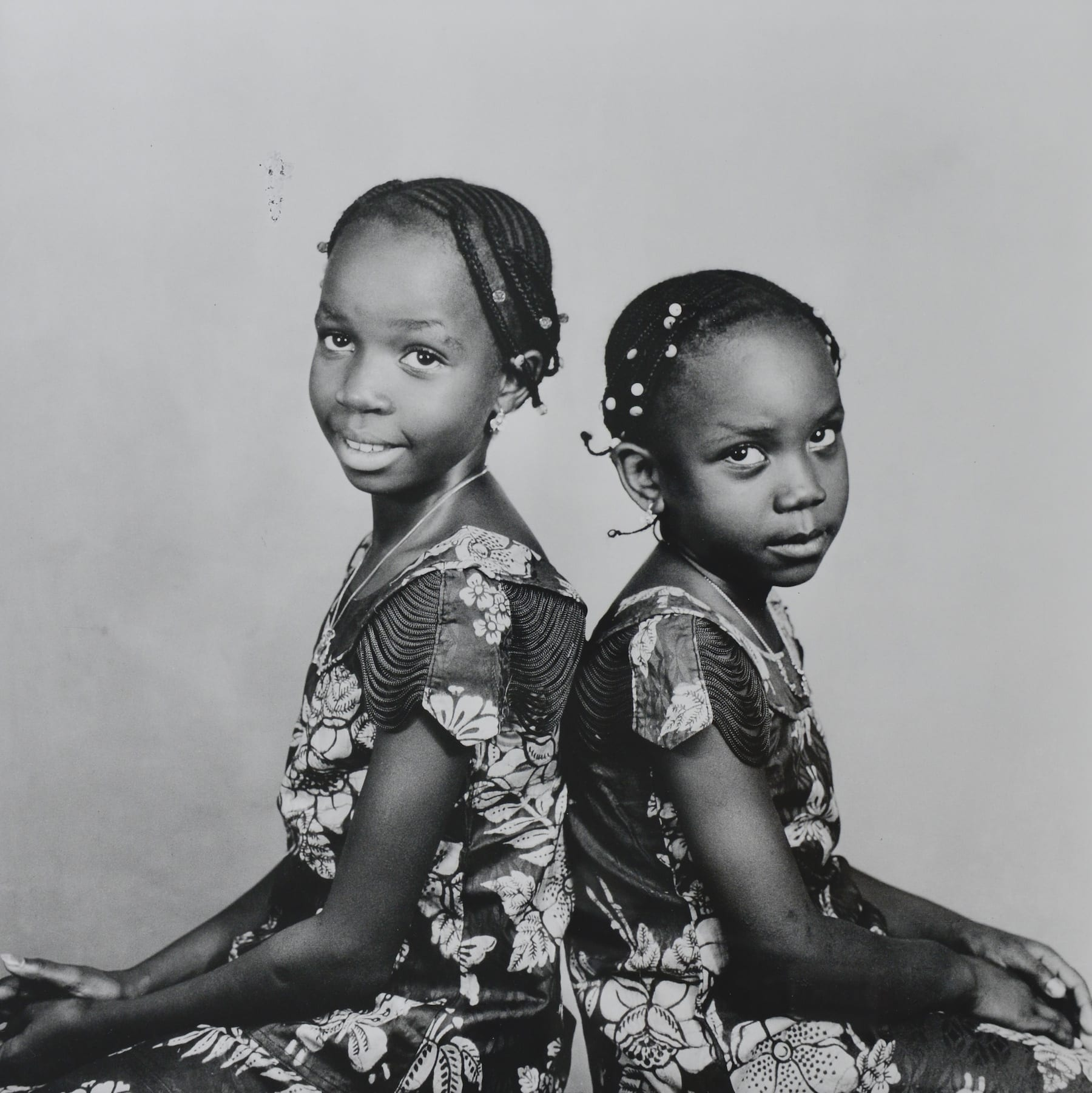 Malick Sidibe-The Two Sisters-HackelBury Fine Art-black and white photograph of two sisters sitting
