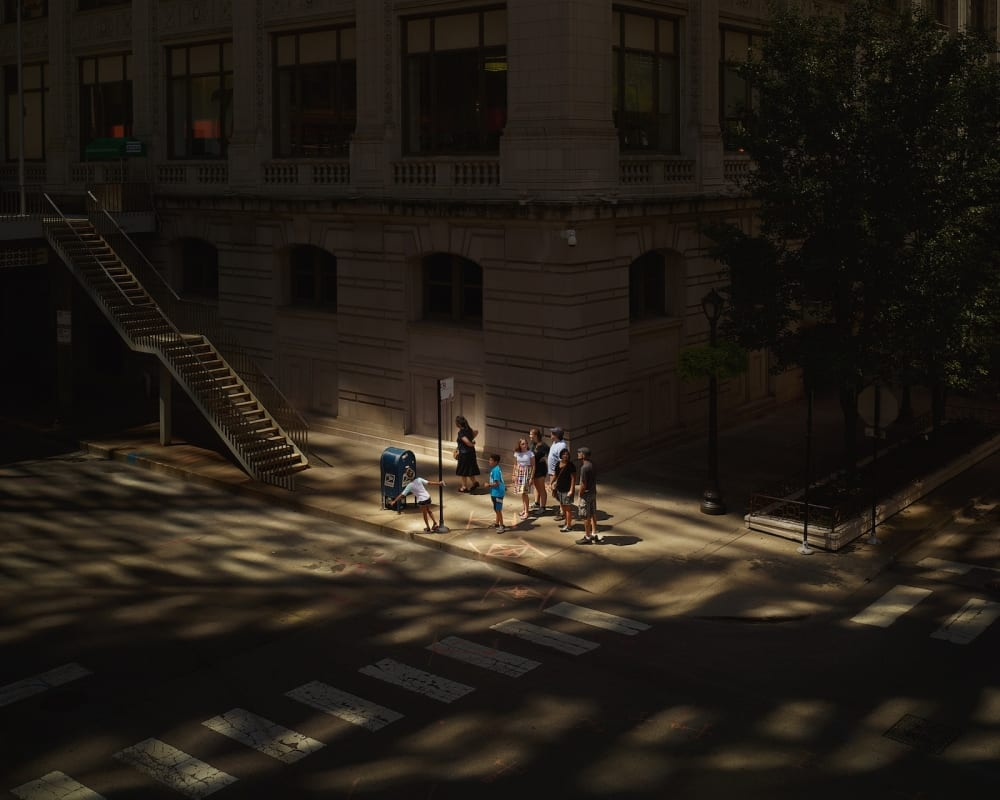 Oli Kellett-Cross Road Blues-Hubbard St Chicago-HackelBury Fine Art London-photograph of family on corner with dappled light