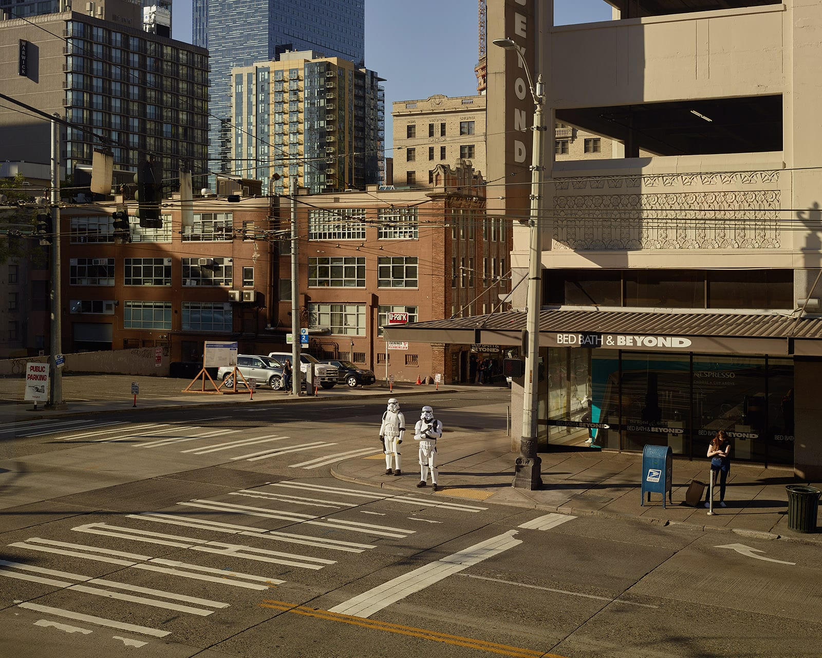 Virginia St, Seattle. Oli Kellett - HackelBury Fine Art London - photograph of two stormtroopers waiting at crosswalk under bed bath and beyond sign