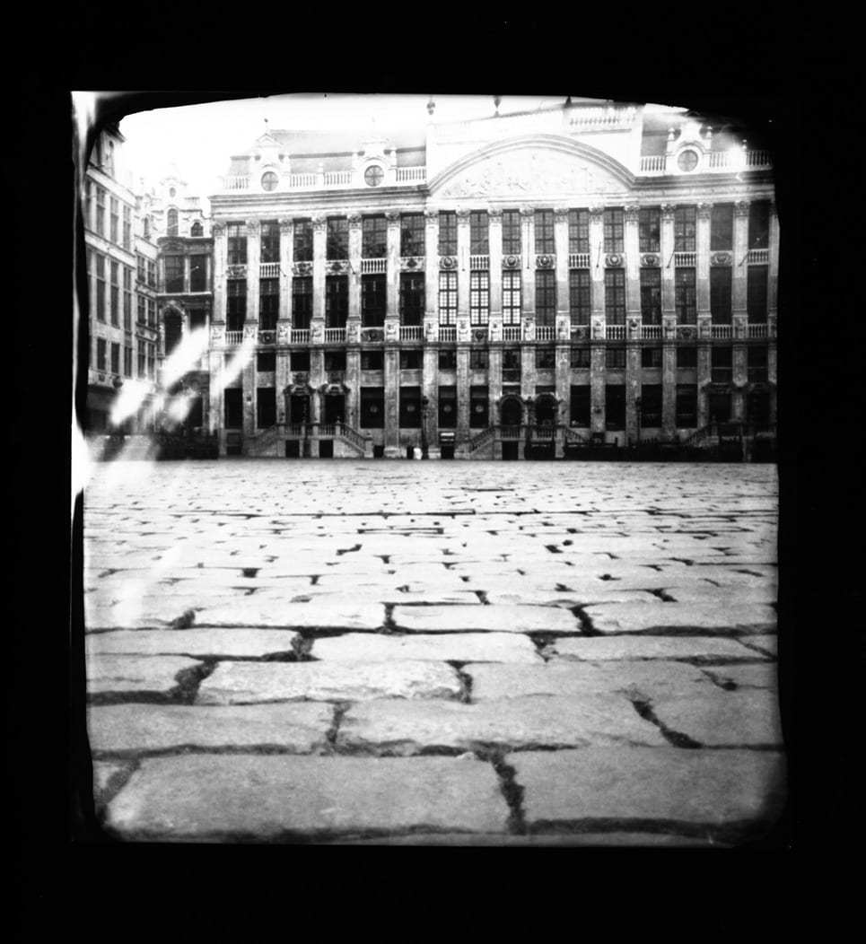 Pinhole-Brussels 1(market)-Katja Liebmann-HackelBury Fine Art-black and white photograph of buildings and cobblestones