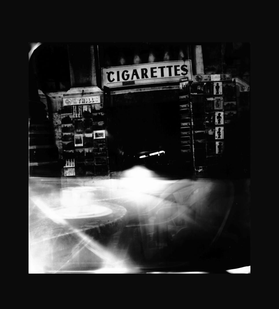 Pinhole-Brussels 3 (kiosk)-Katja Liebmann-HackelBury Fine Art-black and white photograph of kiosk with cigarettes sign