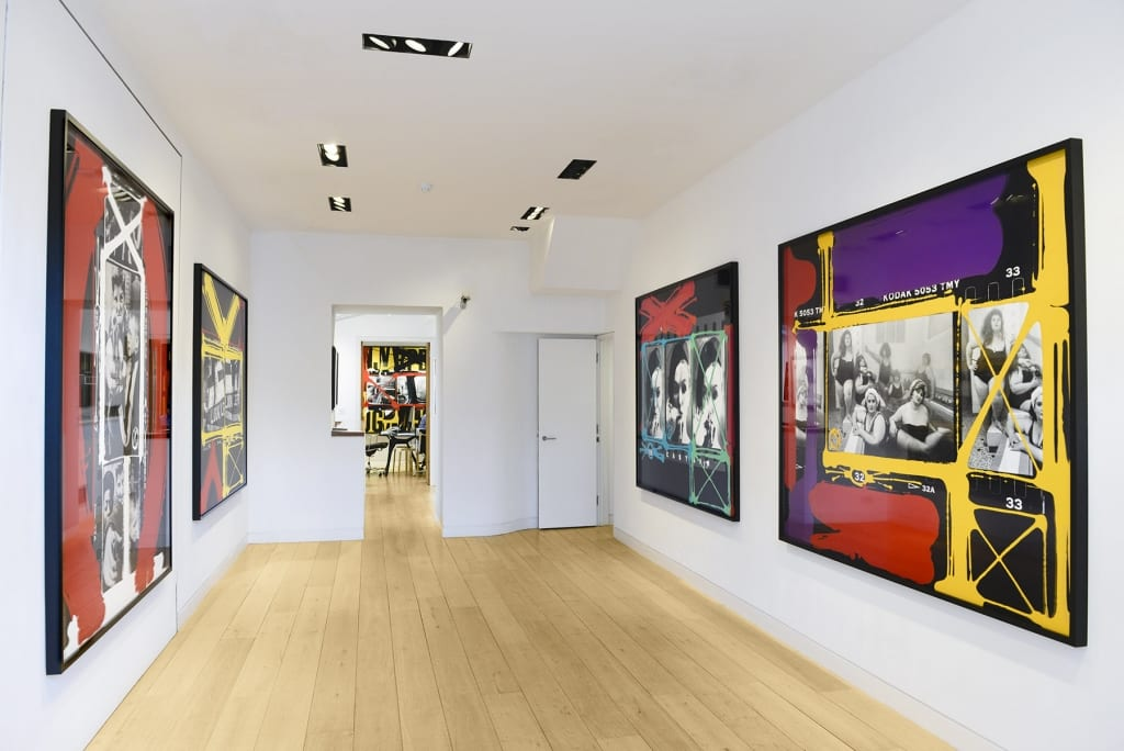 Gallery installation of four large colourful artworks