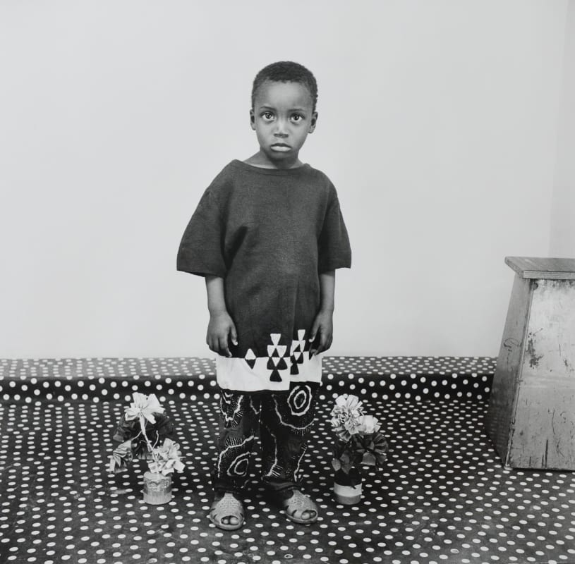 Malick Sidibé - Studio Portrait, A Child In Love with Flowers, 1975